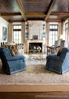 The living room began as a very neutral space; its pecky cypress ceilings stained a warm brown rather than the traditional beachy gray.