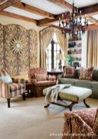 The family room's chocolate brown print was an instant favorite, but the designers were hesitant to use it for window treatments because there are so many windows.