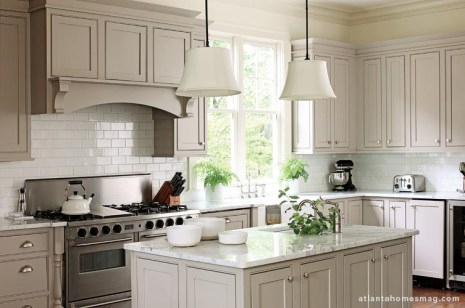 Although the kitchen had been completed by the previous owner, it beautifully complements Howard's designs in the surrounding spaces—from its simple-but-sophisticated style to the subdued color scheme.