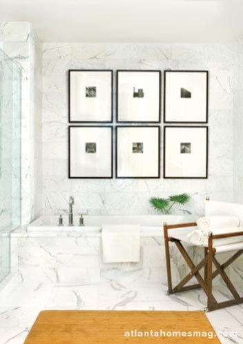 To create an en suite effect, Brown used a series of prints in the bedroom and continued them in the master bath.