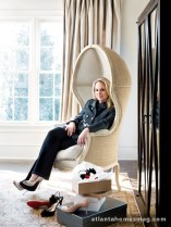 A hooded chair in Morris' bedroom seems the perfect place to decide among Christian Louboutin or Jimmy Choo shoes.