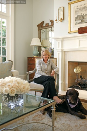 Homeowner Beth Elsey, with her Labrador Emma, relaxes in the formal living room.