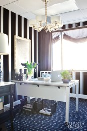 """Using Kris Jenner""""s personal sense of fashion as inspiration, Brian Patrick Flynn covered the walls of associate Liz Killmond""""s office with dramatic, menswear-inspired """"Flocked Stripe"""" wallcovering from Graham & Brown. The office of Killmond""""who manages Kris Jenner""""s youngest daughters, Kendall and Kylie""""features a patterned rug from Karastan."""