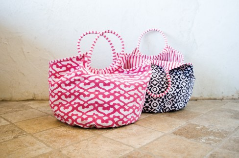 Cotton beach bags in pink and navy, $80 each. B.D. Jeffries