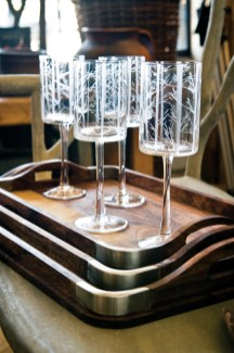 "Etched birch wine glasses, $15 each. Anthony | Wolf, set upon ""Hemingway"" nesting trays, $55-$95 each, B.D. Jeffries"