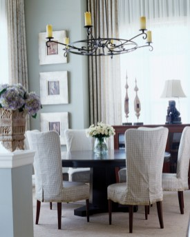 91) Joel Kelly used casual, yet tailored slipcovers on the dining room chairs at an oceanside vacation home.
