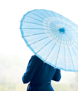 April showers bring May flowers and when the sun breaks through the clouds, take cover from harsh rays under this 33-inch turquoise blue-and-white parasol with swirl pattern. $7.95, lunabazaar.com.