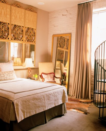 50) This elegant bedroom by Joel Kelly features ornate furnishings against a loft-style backdrop.