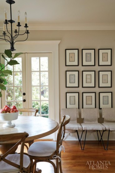 In the dining area, vintage diner chairs, once covered in unsightly linoleum, are now upholstered in lovely linen. Barfield aligned three to craft a makeshift bench. The egg prints were among the first items she purchased for the home, from friend and framer Marie Mealor of Marie Mealor & Associates.