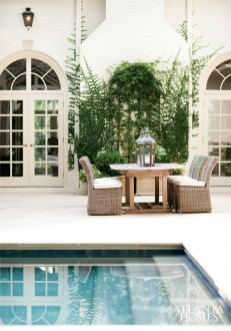 An outdoor dining table just steps from the kitchen makes serving meals al fresco a breeze.