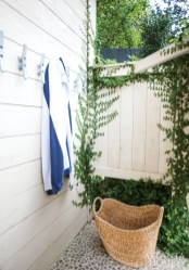 Boat cleats provide a spot to hang towels in the outdoor shower.