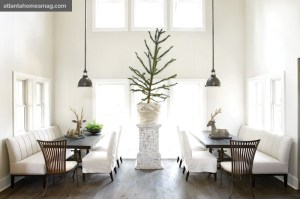 When the dining area needs to accomodate a larger group, a third table can be added in the middle to create one long space for eating. The Araucaria araucana tree is native to Brazil.