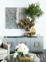 Creme de menthe-colored finish and an antique mirrored glass top are highlights of the Tod Credenza, available through Bradley Hughes. The mixed media artwork is titled Currents and was created by Patrick DeAngelis.