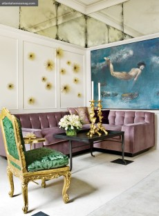 Designer Melanie Turner created a sitting area at one end of the dining room. Starburst accessories above the furniture add dimension to the space.