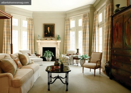 """In the master bedroom and throughout the house, walls, baseboard and trim were all painted one color. """"It's a very European approach,"""" says Murphy. """"It makes the 13-foot ceilings seem even taller, the spaces more open. And given all the door casings, crown moldings and pilasters, white trim would have been jarring to the eye."""" The master bedroom's paint color is Fenland by Sherwin Williams."""