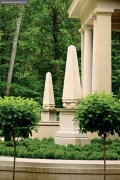 A pair of obelisks flanks the grand entrance to this Italian villa-style home. The gardens were landscaped by William Smith.