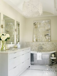 10. A freestanding nickel tub, a sparkling chandelier hung from an arch-top ceiling and art from Anne Irwin Fine Art fashion a glamorous space by interior designer Courtney Giles.