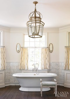 6. White marble tiles, mercury glass sconces and a lee jofa print create an ethereal effect in a bath by Liz Williams and Stan Dixon.