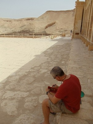 In Egypt, architect Keith Summerour sketches at Hatshepsut Temple near Luxor.