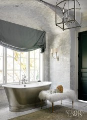 2. A feeling of tranquility permeates this dream-like space by Amy D. Morris. A luxurious french bateau-style soaking tub radiates calmness.