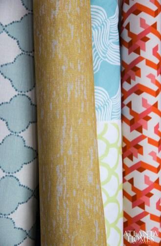 Rolls of fresh fabric include Medallion, Rain, Wave, Arch and Edo.
