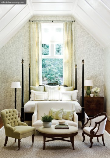 A subtle pattern on the walls and window treatments not only warms up this room but also creates a sense of intimacy. A seating area further enhances the cozy feeling.