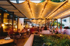 The contemporary yet comfortable ambiance in Ford Fry's latest restaurant, King + Duke, extends to its outdoor seating options.