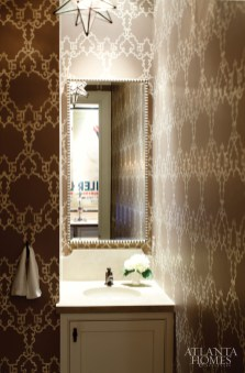 5. A limestone countertop, moravian star pendant and arabesque-style Nina Campbell wallpaper pack in the punch at the hands of Lauren Deloach and Spitzmiller and Norris.