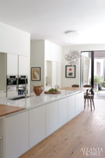 The couple loved the SieMatic cabinets from their previous home, so they selected the company's channel cabinets for this kitchen. Counters, Silestone. Appliances, Miele. Faucet, Blanco.
