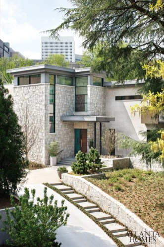 To soften its approach from the street-and marry the modern home to its Midtown location-the architects designed granite landscape walls that engage the exterior and soar skyward.