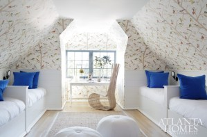 To soften the bunk room's angles, Turner covered the walls in a whimsical bird-print wallpaper by Schumacher.