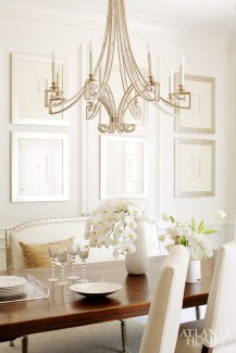 In the dining room, a collection of intaglios framed in silver and a jewel-like chandelier fashion a sparkling state for meals with family and friends.