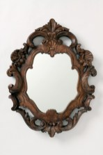 Acacia wood Organic Rococo Mirror, $398. Anthropologie