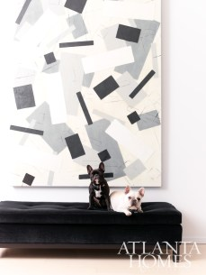"On a plush Sammy Cocktail Ottoman, Baker and Fr�?©re rest their paws by Christine Vaillan-court""s large acrylic art."