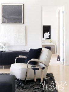 """Mitchell Gold + Bob Williams"""" Art-Deco inspired Dean II Leather Chair sits beside the stainless steel-clad Dax Table in the living room of this uber-contemporary residence."""