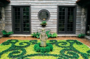 """Green is nature's neutral,"" says Farmer, illustrating the point with this ornamental garden that incorporates both chartreuse and dark green groundcovers."