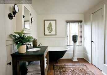 """The old tub was original to the Madison house when the couple purchased it, but that""""s all that remains intact in the master bath."""