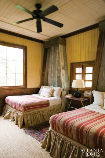 The two guest bedrooms each include two queen-size beds, which evoke images of rough-hewn boats.