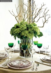 Pops of Color Emerald-green Saint-Louis crystal glasses, Puiforcat silver flatware and Hermes china look dazzling alongside a sculptural floral arrangement composed of hydrangea and driftwood. All pieces available through Hermes of Paris in Buckhead.