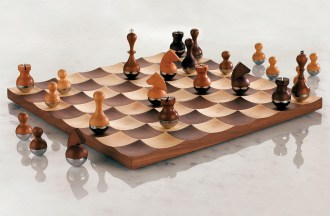 """Wobble"" walnut chess set by Umbra, $275. W Atlanta - Midtown gift shop, 188 14th St. NE, Atlanta 30361. (404) 892-6000"