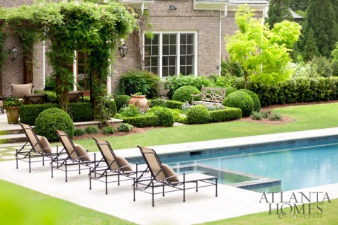 """""""The back terrace needed to relate to the pool space,"""" Smith says. Limestone, which borders the pool, was also used for the terrace."""