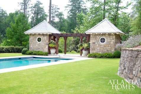 Todd Pullen, in-house architect at Alex Smith Garden Design, designed the pair of pool pavilions. The pool deck's transition from limestone to grass, says Smith, is seamless.