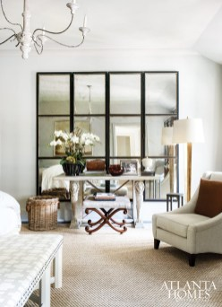 A vintage mirrored screen from Parc Monceau creates the illusion of space in the master bedroom. Console, David Iatesta at Ainsworth-Noah.