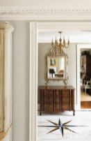 Like many of Askins's renovations, this astute example showcases raised doorways, which creates the illusion of height. Both are trimmed with intricate moldings, including a custom corkscrew casing base.
