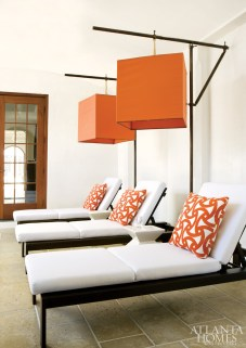 On the terrace, Douglass glams up outdoor loungers from West Elm with custom orange basket lanterns overhead.
