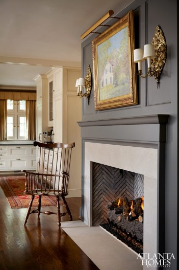 In the breakfast room, a comb-back Windsor chair by the fireplace reveals the homeowners' love for antiques.