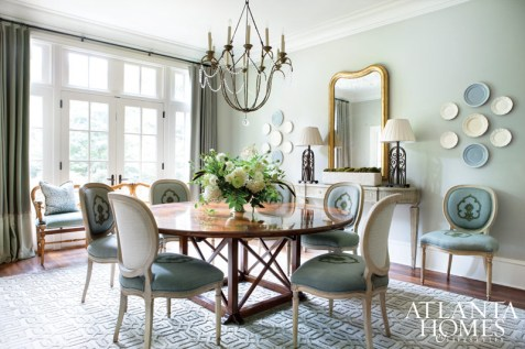 In the dining room, Liz Williams acheived a balance between the formal and the relaxed, pairing soft textures with subtle shades. At the request of the homeowners, who entertain often, the designer specified a round table. A comfortable settee and groupings of creamware round out the space.