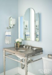 Silver Gray by Benjamin Moore creates a calming effect in the powder room. Vanity by Kallista.