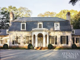 Architect D. Stanley Dixon imbued new life to a 1970s colonial revival home originally designed by architect James Means. Dixon added a lime wash to the brick facade, as well as a slate roof, Georgian-influenced portico and new dormer windows.