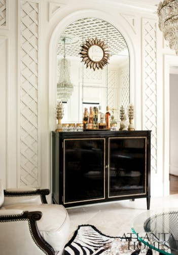 The black-and-gilt chest holds bar essentials and spirits, which are used to make the Roulands' favorite cocktail, a Paper Moon (visit atlantahomesmag.com for the recipe).